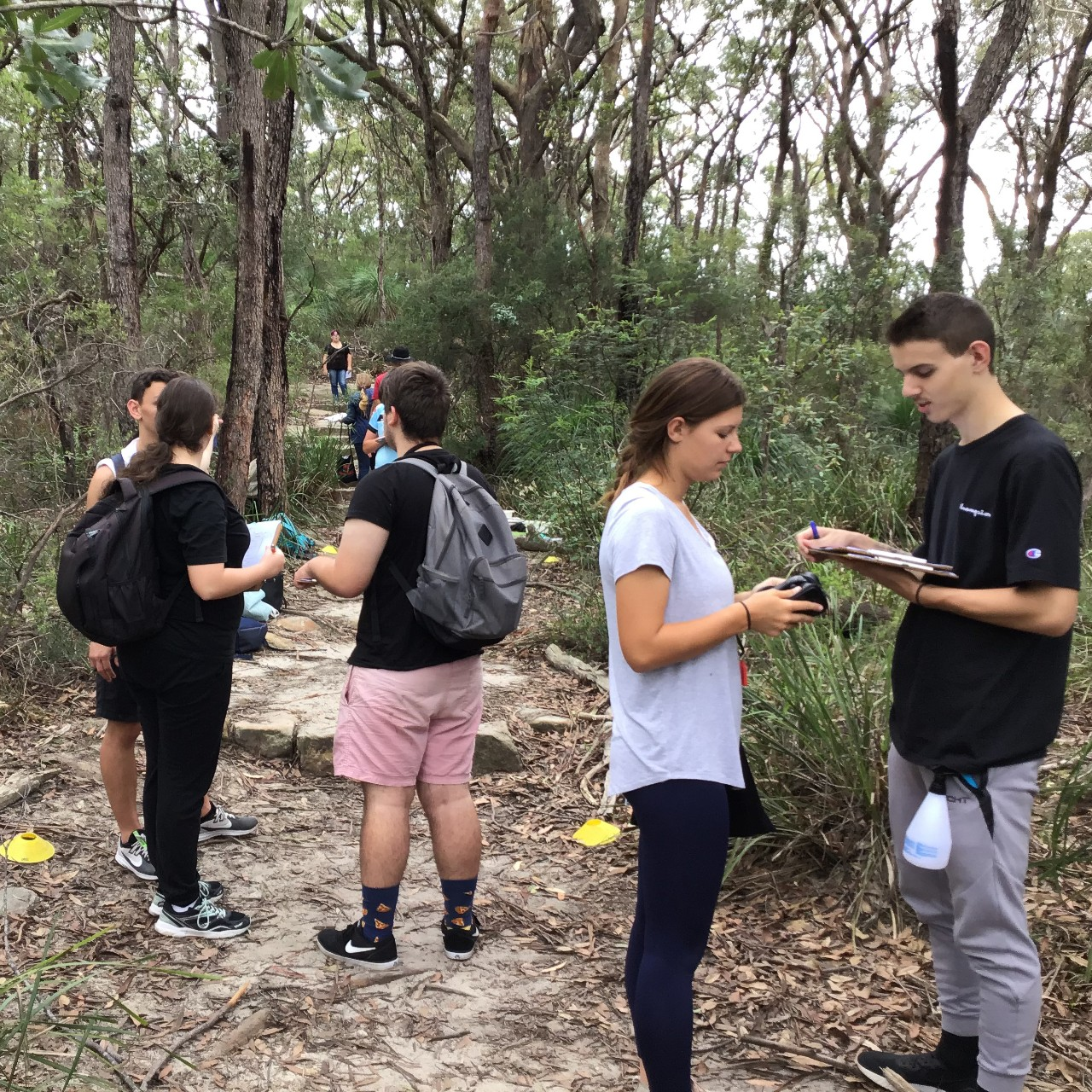 students conducting biology fieldwork